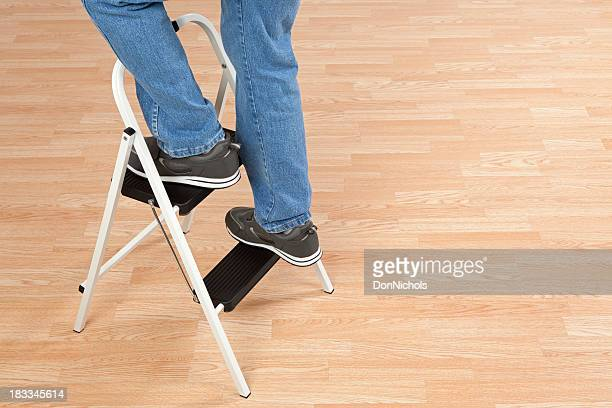 standing on a step ladder - step ladder stock photos and pictures