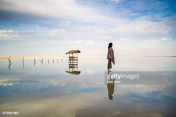 Standing on the mirror lake of dead sea