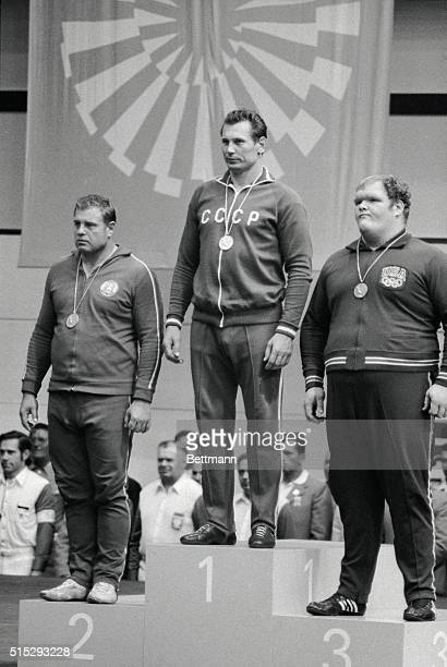 Standing on the podium after receiving their Olympic medals for the over 100 kg free style wrestling event are left to right Osman Douraliev of...