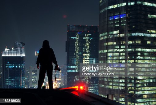 Standing On The Roof Top Of A Building Stock Photo Getty