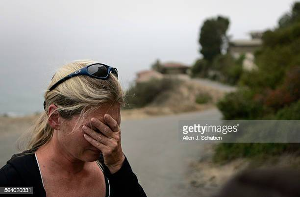 Standing on the trail where he went missing Maria Mayenzet cries as she talks about her search for her father Andre Mayenzet an 83–year–old Laguna...