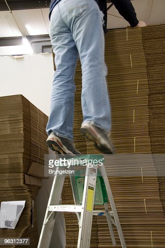 Standing On Top Rung Of Ladder Stock Photo Getty Images