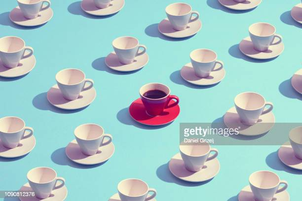 standing out from the crowd - coffee stock pictures, royalty-free photos & images