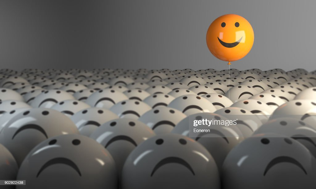 Standing Out From The Crowd With Smiling Sphere : Stock Photo