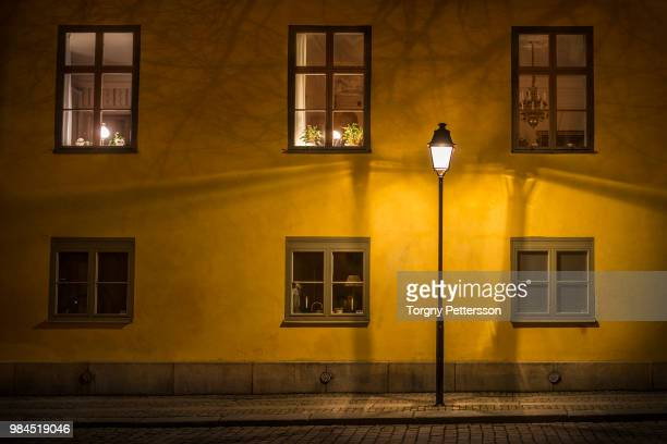 standing outside - street light stock pictures, royalty-free photos & images