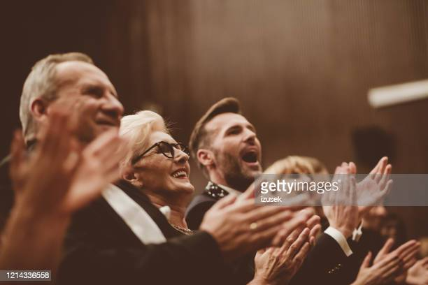 standing ovation in the theater - awards ceremony stock pictures, royalty-free photos & images