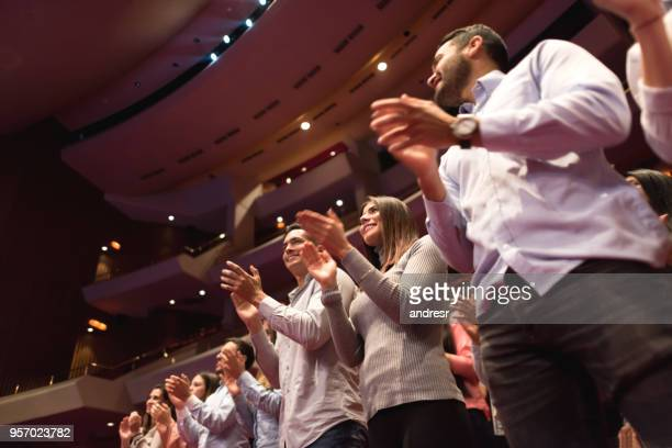 standing ovation on the public after a beautiful ballet performance - performance stock pictures, royalty-free photos & images