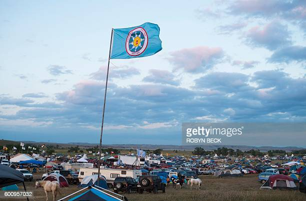 A Standing Rock Sioux flag flies over a protest encampment near Cannon Ball North Dakota where members of the Standing Rock Sioux tribe and their...
