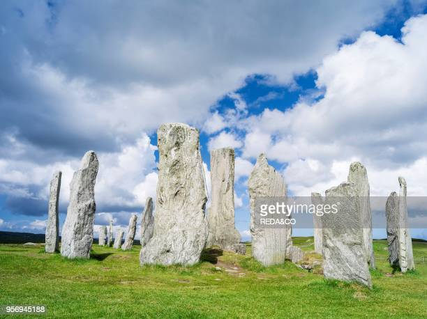 Standing Stones of Callanish on the Isle of Lewis in the Outer Hebrides The megalithic monument is cross shaped with a central ring of stones and was...