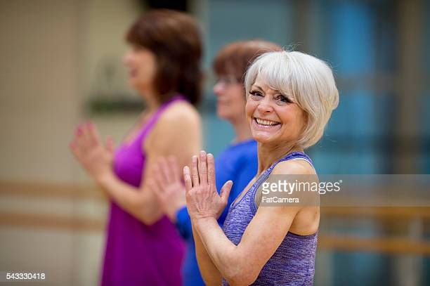 standing together in tree pose - tree position stock photos and pictures