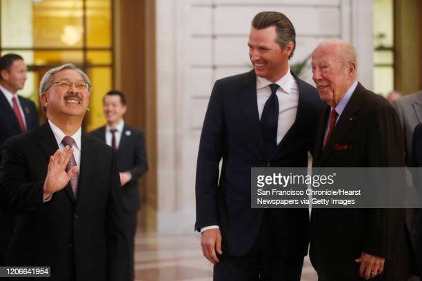 Standing together under the rotunda, Mayor Ed Lee, Lt. Governor Gavin Newsom and former Secretary of State George Schultz await the arrival of French...