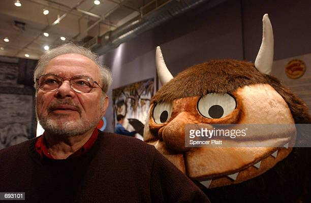 Standing with a character from his book 'Where the Wild Things Are' author and illustrator Maurice Sendak speaks with the media January 11 2002...