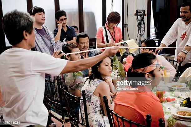SANTOS MINDANAO PHILIPPINES Standing with a scarf comedy Director Wenn Deramas sitting ExPresident Joseph Estrada with actress Ai Ai delas Alason the...