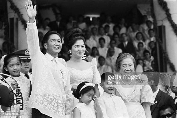 Standing with his family Ferdinand Marcos waves to the crowd after his inauguration as the President of the Philippines on December 30 1965