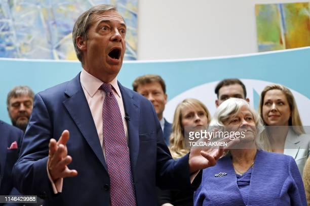 Standing with his fellow MEPs Brexit Party leader Nigel Farage speaks to members of the media at a postEuropean Parliament election press call in...
