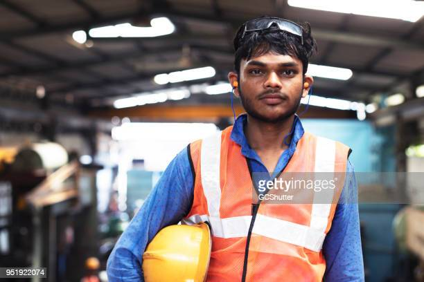 standing with the hard hat at his side - ear protection stock pictures, royalty-free photos & images