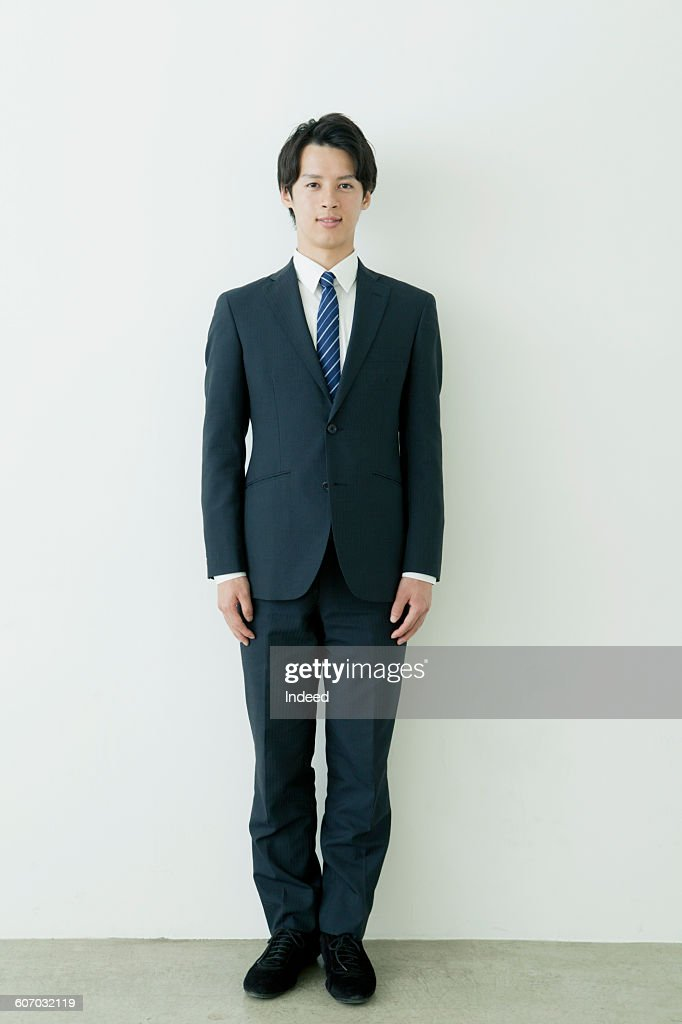 Standing young businessman : ストックフォト