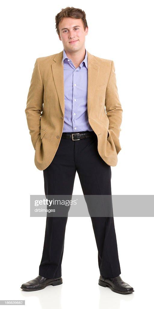 Standing Young Man Smirking : Stock Photo