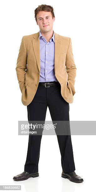 standing young man smirking - legs apart stock pictures, royalty-free photos & images