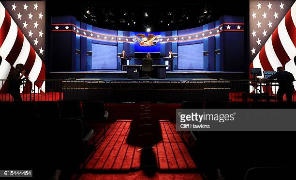 Standins for Democratic presidential candidate Hillary Clinton and Republican presidential candidate Donald Trump prepare for the final presidential...