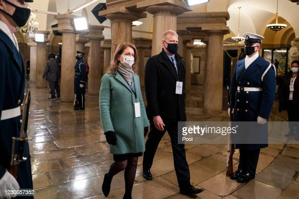 Stand-ins portraying President-elect Joe Biden and his wife, Dr. Jill Biden, walk through the Capitol Crypt during an inauguration rehearsal in the...