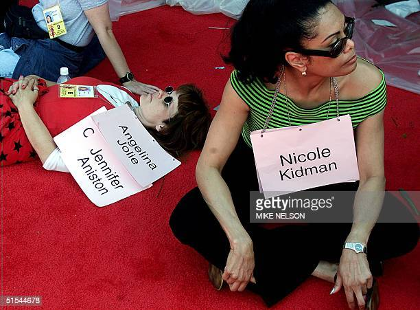 Standins representing actors Angelina Jolie Jennifer Aniston and Nicole Kidman rest during preparations for the 72nd annual Academy Awards 24 March...