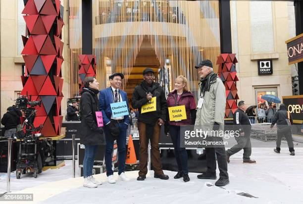 Standins wearing name tags representing host and movie stars rehearse for the pre telecast show on the red carpet during preparations for the 90th...