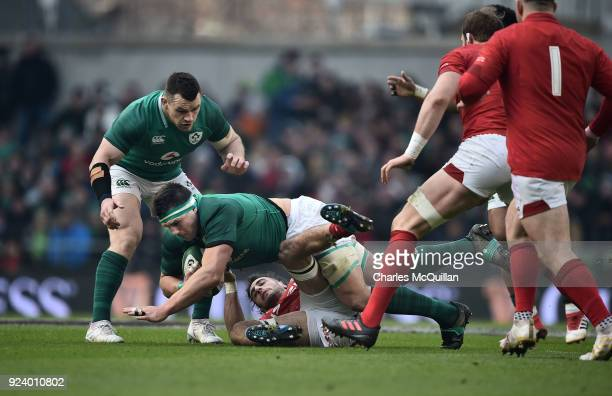 Standler of Ireland and Josh Navidi of Wales during the Six Nations Championship rugby match between Ireland and Wales at Aviva Stadium on February...
