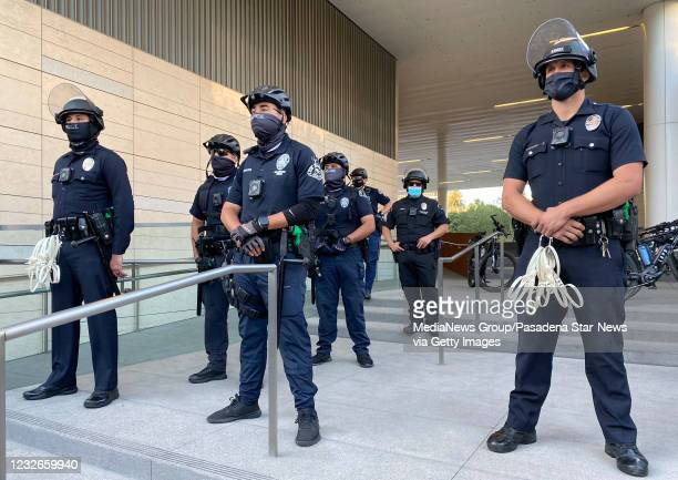 Stands guard outside the Police Headquarters as demonstrators protest of the death of George Floyd, a black man who was in police custody in...