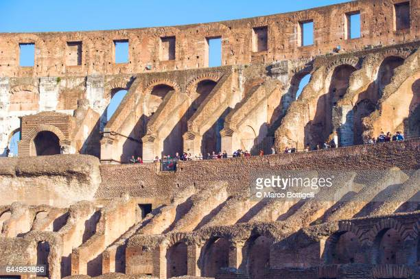 stands of the colosseum. rome, italy. - inside the roman colosseum stock photos and pictures