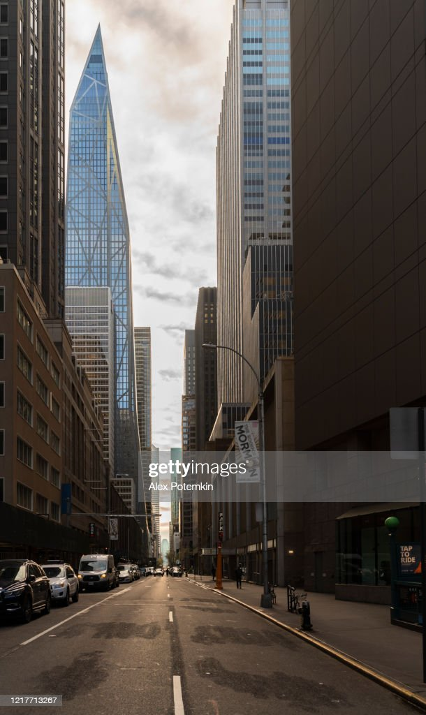 A standstill street of Midtown Manhattan, usually crowded by pedestrians and cars, is abandoned due to the novel coronavirus outbreak.  A view along 53d street from 7th Avenue, towards Tower Verre, now known as 53W53 building. : Stock Photo
