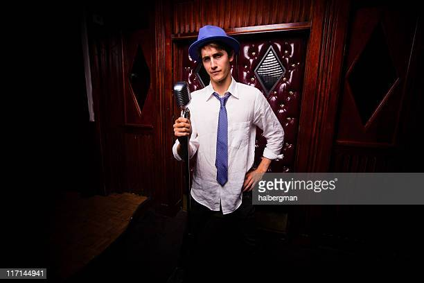 stand-up comedian in a seedy dive bar - comedian stock pictures, royalty-free photos & images