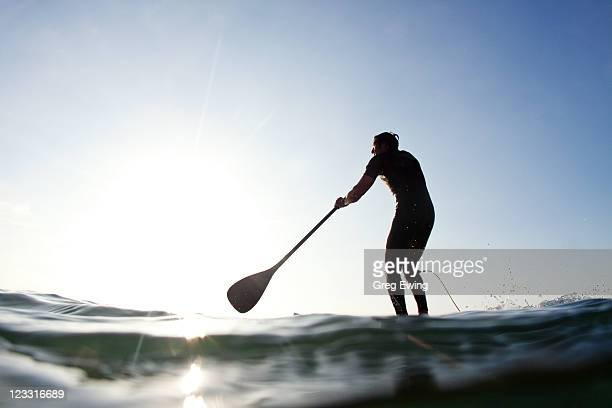 stand-up paddle boarder paddling on sea, durban, kwazulu-natal province, south africa - durban stock-fotos und bilder