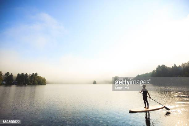 sup - stand-up paddleboard - women in harmony stock pictures, royalty-free photos & images
