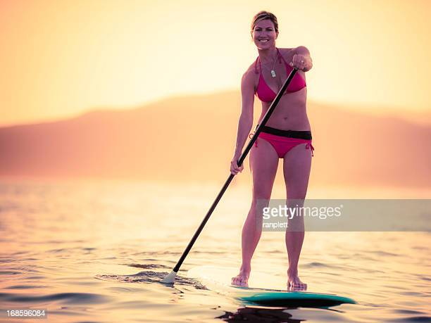 standup paddleboarding - english bay stock photos and pictures