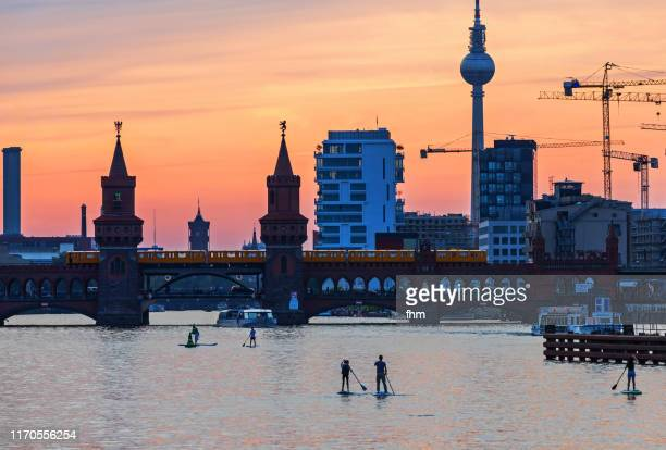stand-up-paddlers on spree river (berlin, germany) - スプリー川 ストックフォトと画像