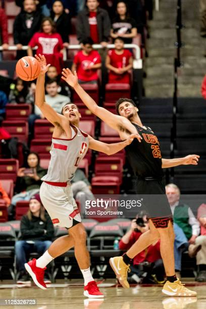 Stanford Cardinal forward Oscar da Silva grabs for a loose ball during the men's college basketball game between the USC Trojans and Stanford...