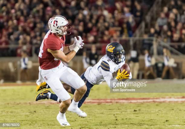 Stanford Cardinal fullback Hannes Bohning grabs for air as California Golden Bears cornerback Darius Allensworth clutches a pass seconds before...