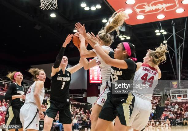 Stanford Cardinal guard Brittany McPhee vying for the rebound against Colorado Buffaloes forward Makenzie Ellis and Colorado Buffaloes guard Ariana...