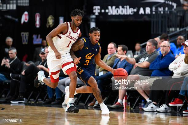 Stanford Cardinal guard Daejon Davis closely guards California Golden Bears guard Paris Austin as he brings the ball up the court during the first...