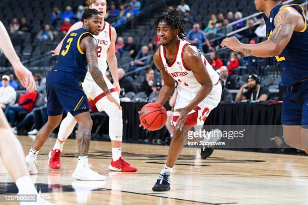 Stanford Cardinal guard Daejon Davis drives to the basket during the first round game of the men's Pac12 Tournament between the Stanford Cardinal and...