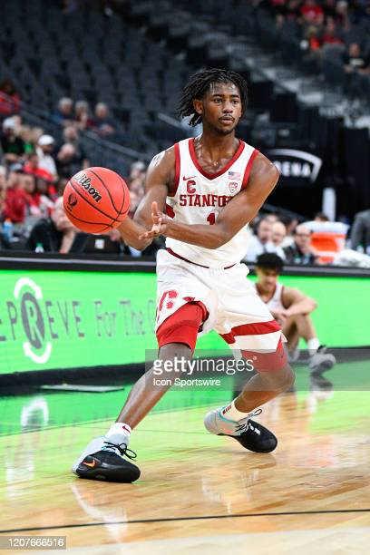 Stanford Cardinal guard Daejon Davis sets up the offense during the first round game of the men's Pac12 Tournament between the Stanford Cardinal and...