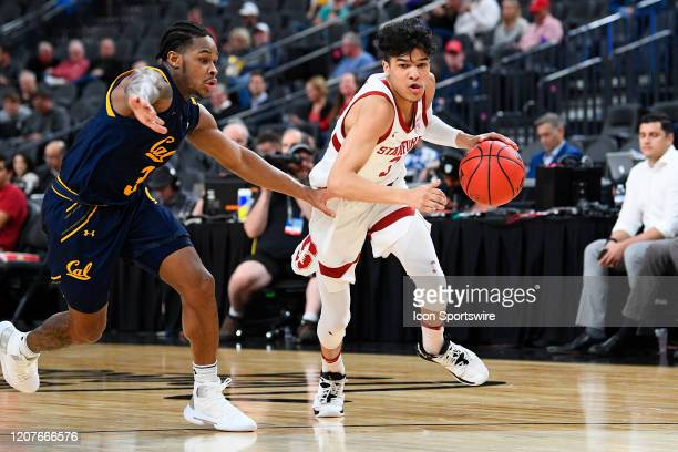 Stanford Cardinal guard Tyrell Terry drives past California Golden Bears guard Paris Austin during the first round game of the men's Pac12 Tournament...