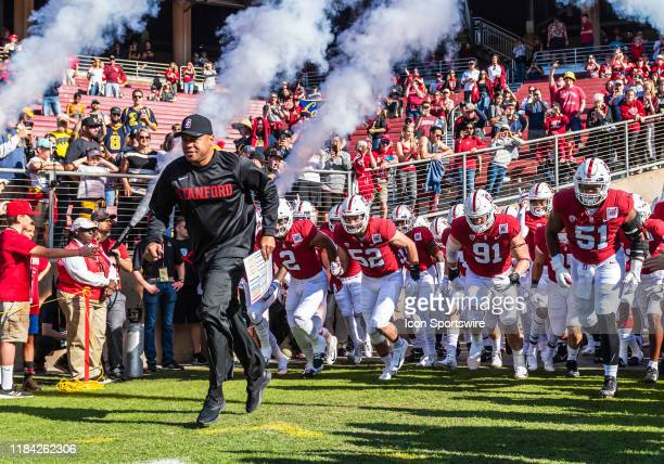 Stanford Cardinal head coach David Shaw leads his team out onto the field at the start of the game between the California Golden Bears and the...