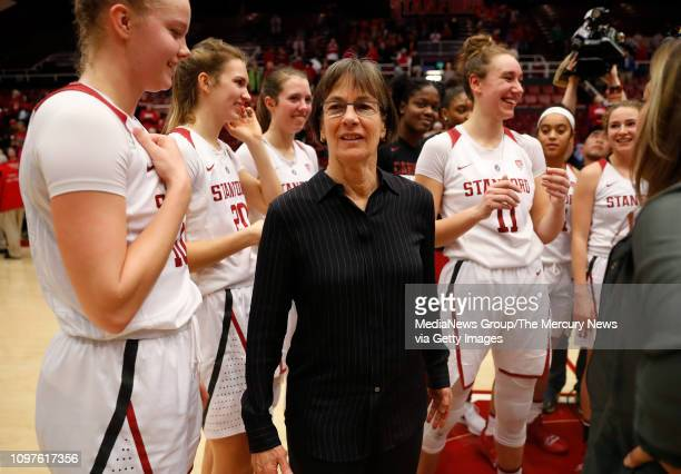 Stanford Cardinal head coach Tara VanDerveer is surrounded by players after the Cardinal's 85-64 win over the Washington State Cougars at Maples...