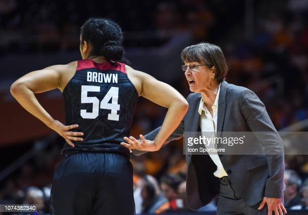 Stanford Cardinal head coach Tara VanDerveer talking to guard Jenna Brown during a college basketball game between the Tennessee Lady Volunteers and...