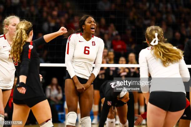 Stanford Cardinal middle blocker Tami Alade celebrates after scoring a point in the 5th set during the match between the Stanford Cardinal and the...