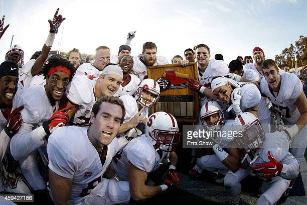 Stanford Cardinal players celebrate with the Axe after they defeated the California Golden Bears in the Big Game at California Memorial Stadium on...