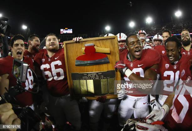 Stanford Cardinal players celebrate with The Stanford Axe after they beat the California Golden Bears at Stanford Stadium on November 18 2017 in Palo...