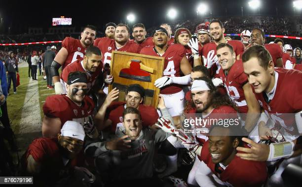 Stanford Cardinal players celebrate with 'The Stanford Axe' after they beat the California Golden Bears at Stanford Stadium on November 18 2017 in...